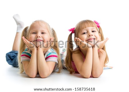 Two kids girls lying together - stock photo