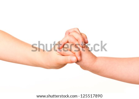 Two kids holding hands together isolated on white. Concept of support, assistance - stock photo