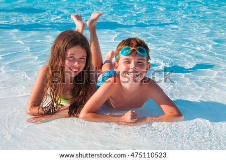 Two kids lying on the beach