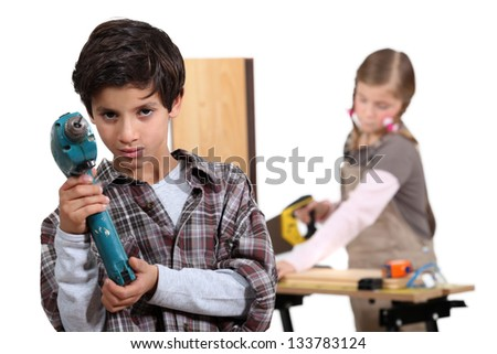 Two kids playing at being construction workers. - stock photo
