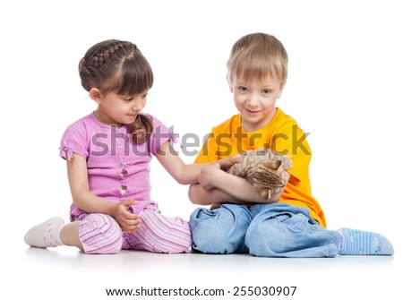 two kids playing with kitten isolated on white