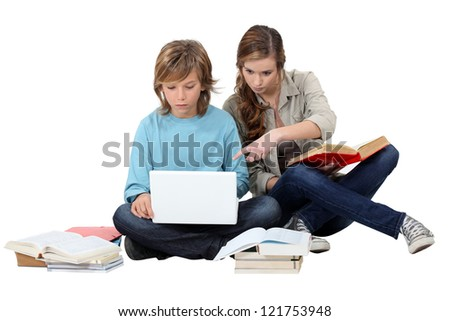 Two kids revising together - stock photo