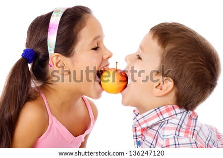 Two kids sharing the apple, isolated on white - stock photo