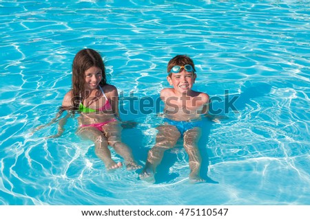 Two kids sitting in water