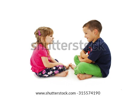 Two kids talking. Isolated on white background - stock photo