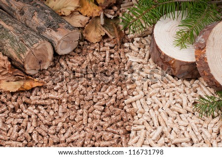 Two kind of pellets and materials pellets made- selective focus on the front - stock photo