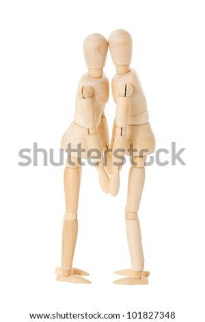 Two kissing wooden dolls over a white background