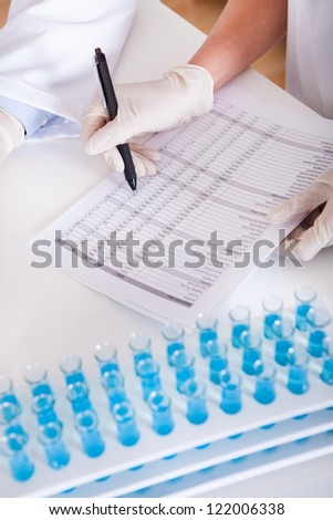 Two lab technicians at work in a laboratory - stock photo