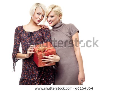 Two ladies holding gift