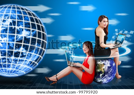 Two lady and digital technology world movement concept : Elements of this image furnished by NASA - stock photo