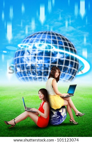 Two lady and digital world background and download concept : Elements of this image furnished by NASA - stock photo
