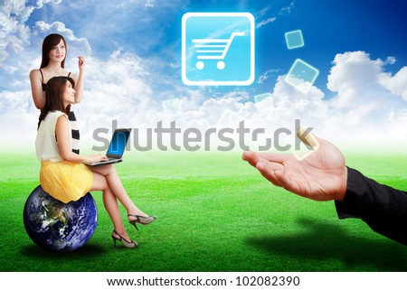 Two lady loo at the Cart icon from the hand : Elements of this image furnished by NASA - stock photo