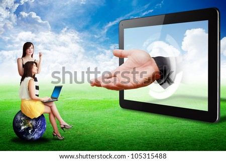 Two lady look at Tablet computer and the hand : Elements of this image furnished by NASA - stock photo