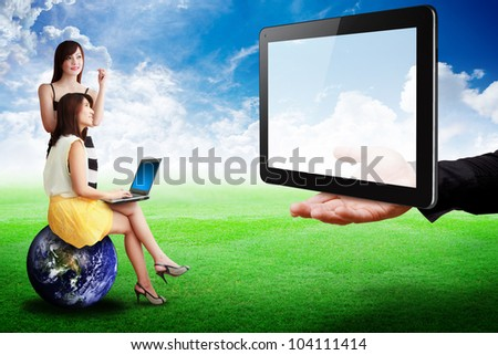 Two lady look at Tablet computer on the hand : Elements of this image furnished by NASA - stock photo