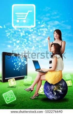 Two lady look at the Cart icon from tablet computer : Elements of this image furnished by NASA - stock photo