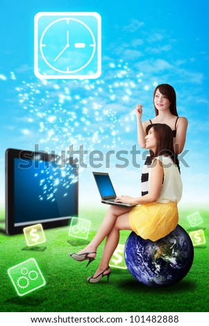 Two lady look at the Clock icon from tablet computer : Elements of this image furnished by NASA - stock photo