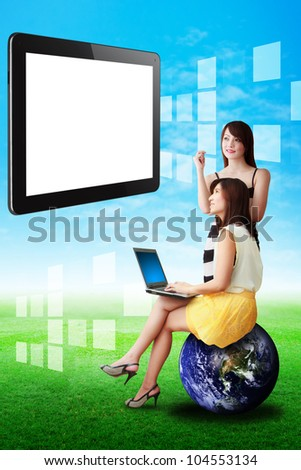 Two lady look at the Digital touch pad on the sky : Elements of this image furnished by NASA