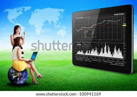 Two lady look at the Graph report on tablet computer on grass field : Elements of this image furnished by NASA