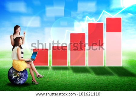 Two lady look at the high graph on the grass field : Elements of this image furnished by NASA
