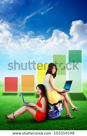 Two lady look at the high graph on the grass field : Elements of this image furnished by NASA - stock photo