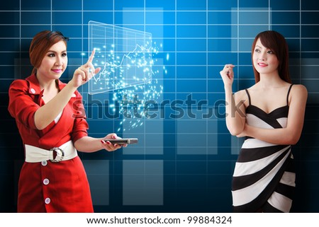 Two lady look at the windows icon from mobile phone - stock photo