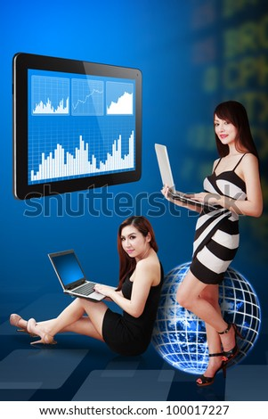 Two lady present the stock exchange graph report : Elements of this image furnished by NASA