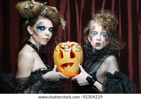 two lalloween girls with pumkin - stock photo