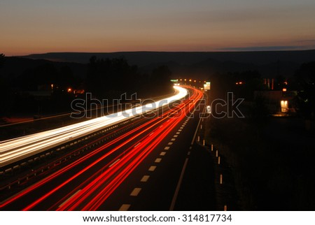 Two-lane highway after sunset