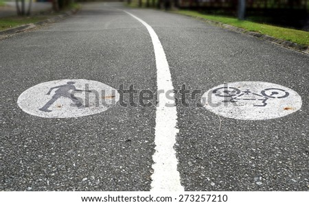 Two lanes with a walkway and bicycle path - stock photo