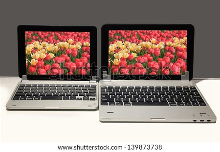 Two Laptops of different sizes are on the table - stock photo
