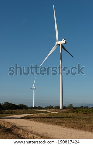 Two large wind turbines in a wind farm in portugal