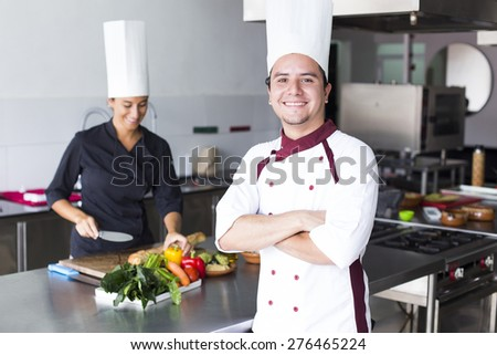 Two latin chefs in a cooking school - stock photo
