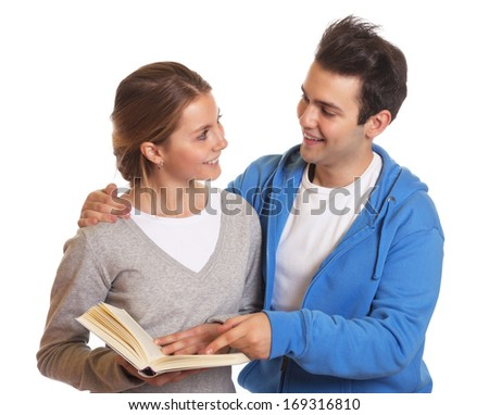 Two laughing students with a book