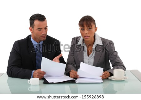 Two lawyers going over notes - stock photo