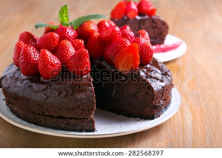 Two layers chocolate cake with strawberry topping