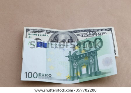 Two leading hard currencies - US Dollar versus Euro - stock photo