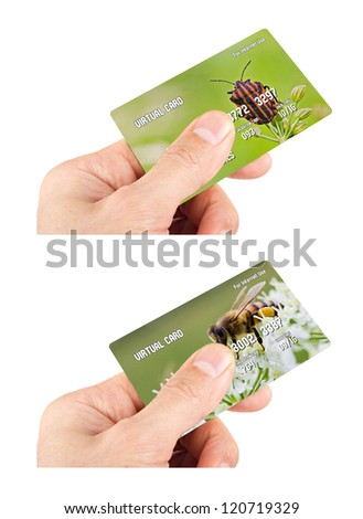 Two left male hands holding credit cards isolated on white