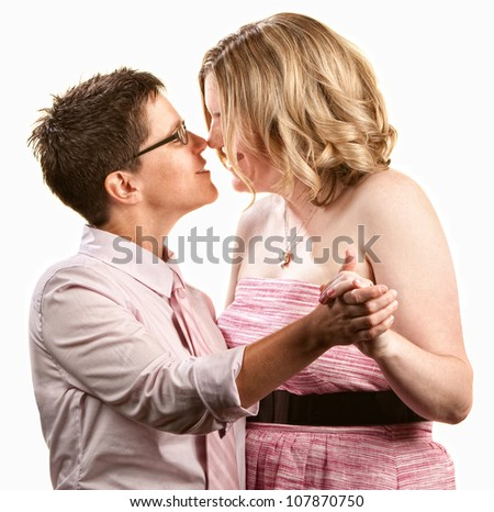 Two lesbian women dancing together over white background - stock photo