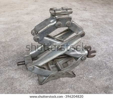 Two level step mechanical screw jack for lifting up vehicles - stock photo