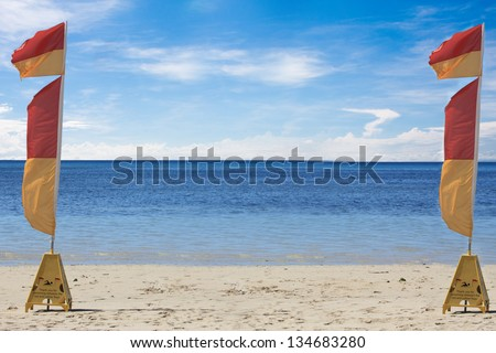 two lifesaving flags on  a tropical beach in Australia - stock photo