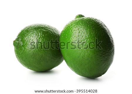 Two limes, isolated on white - stock photo
