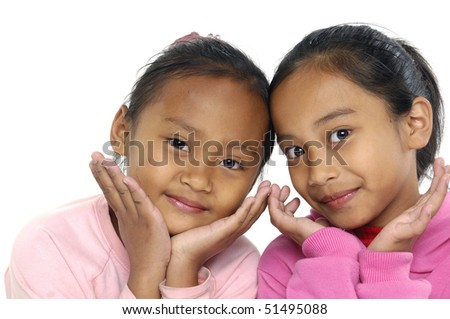 Two little asian girls expressive