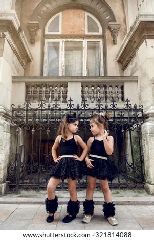 Two little ballerinas dancing in black tutu - stock photo