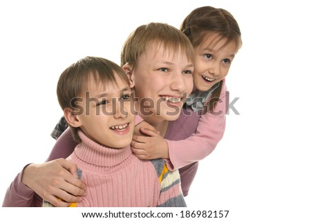 Two little boys and girl on a white background