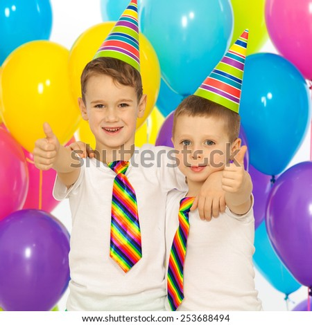 Two little boys at birthday party. Holidays concept.