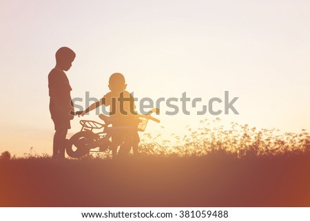 two little boys bike silhouette
