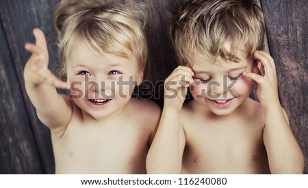 Two little boys on the floor - stock photo