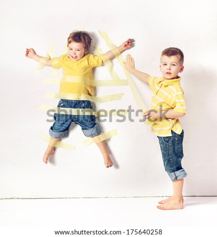 Two little brothers playing - stock photo