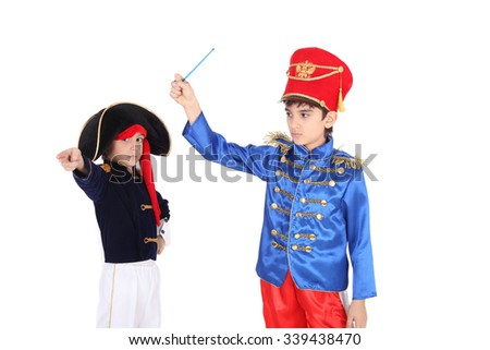 two little children playing the roles of hussars