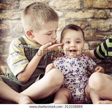 Two little children posing - stock photo